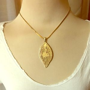 Gold tone metal, crystal leaf necklace
